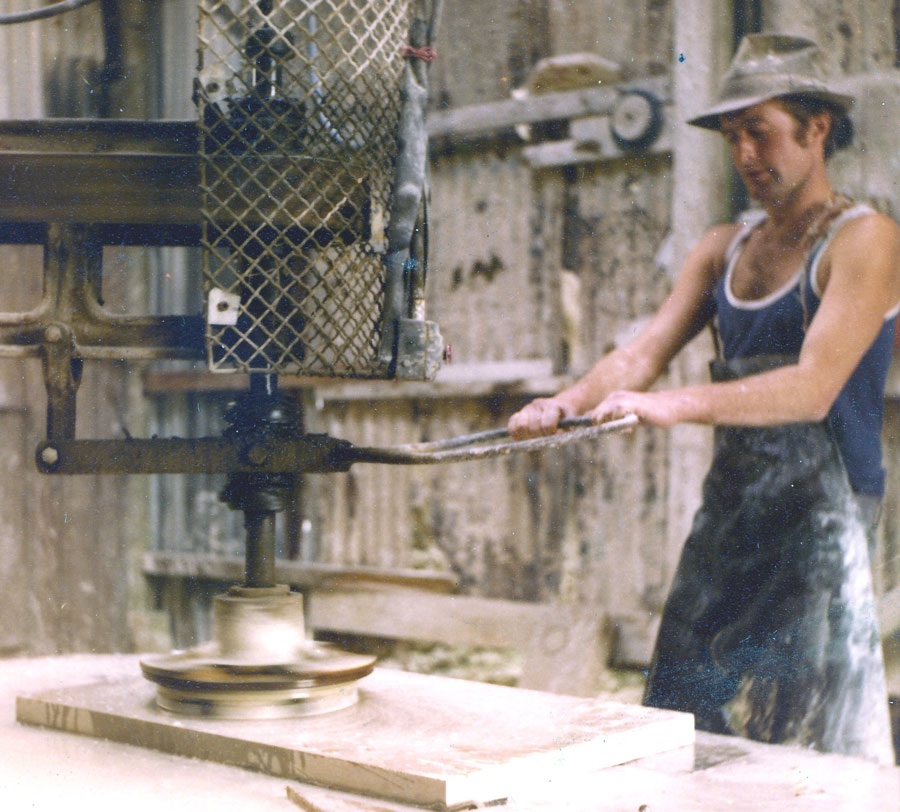 Ilay using the rotating abrasives of a 'Jenny Lind' to polish a hearth at St Aldhelm's Quarry in the late 1970s.