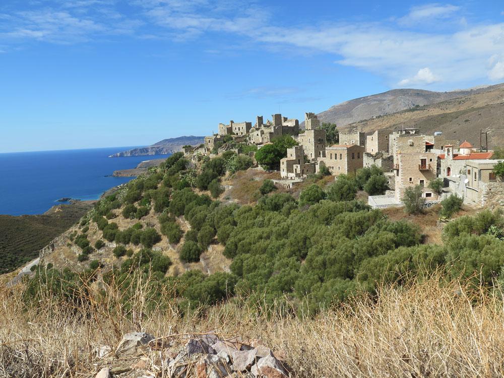Above olive trees, Vathia overlooks the sea.